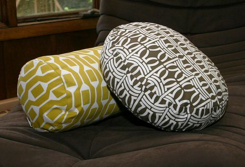 Round pillow togo ottoman