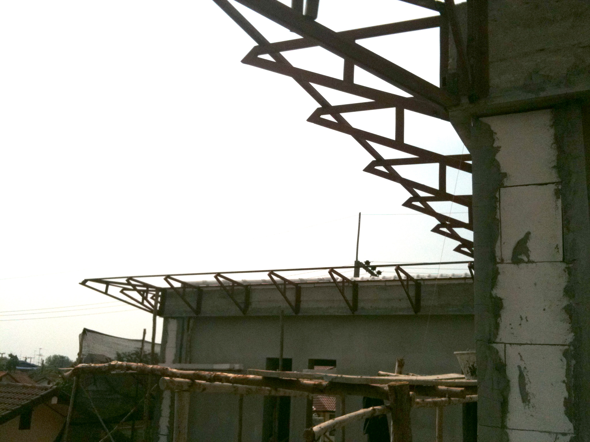 Steel roof wing structure