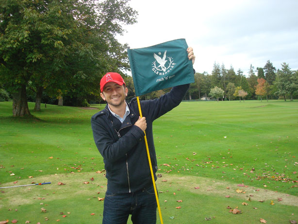Holding Up the Flag at the Last Hole