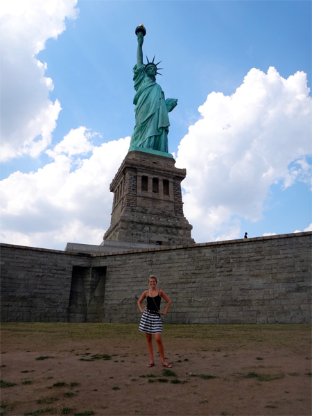 Jenn Standing in Front of the Statue of Liberty
