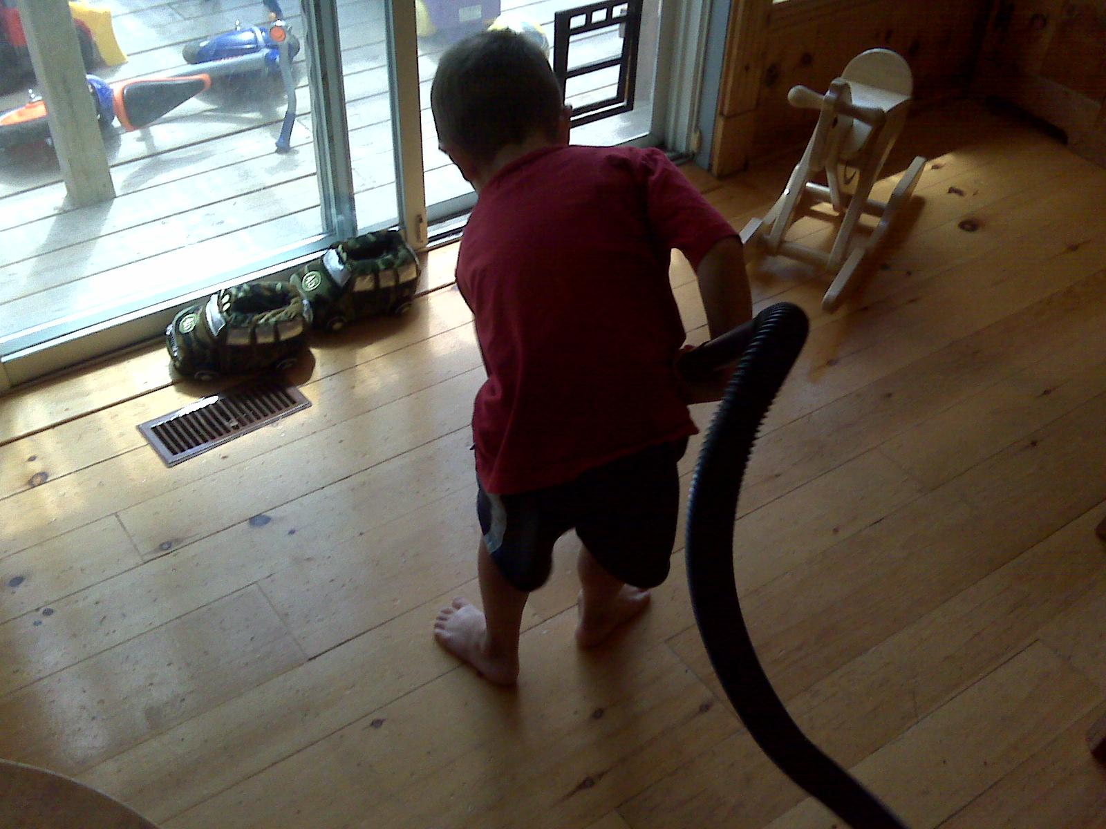 preschooler vacuuming