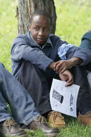 older boy at vbs sitting at tree.jpg