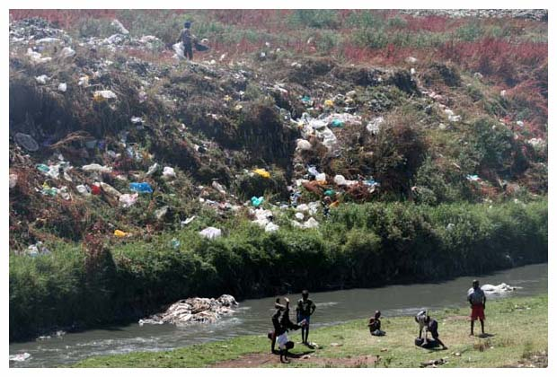 kids playing by river by dump small.jpg