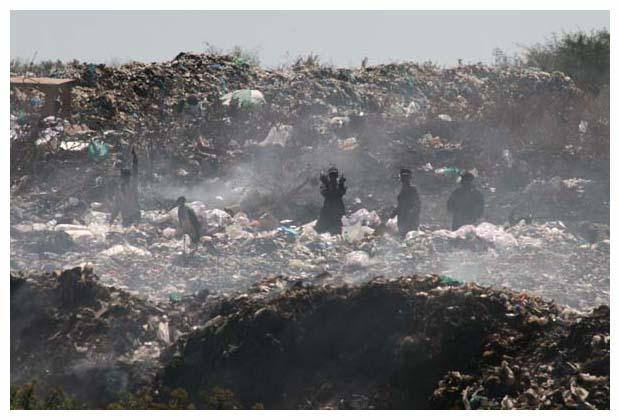 men in dump giving the bird small.jpg