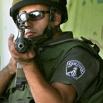 september_6_2005_israeli_soldier_points_his_gun_at_journalists_photo_by_nayef_hashlamouna