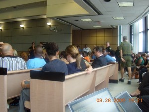 The senior Nathan Walker, on left in blue shirt, joined by other family members in his usual place during the trial: in the courtroom.