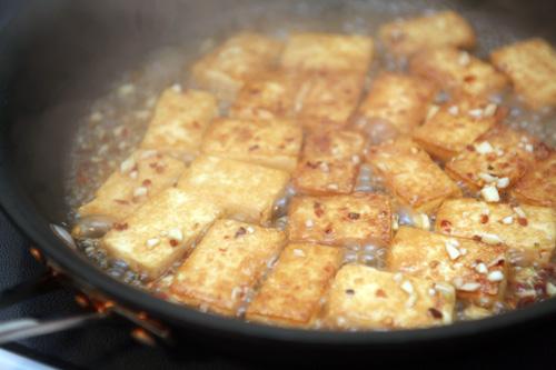 tofu simmering in glaze