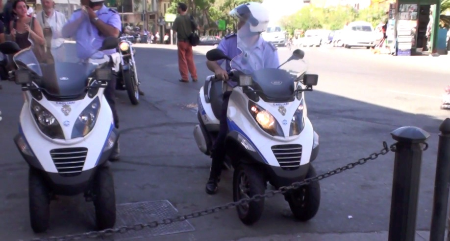 Police in Cagliari Sardinia on their Piaggio MP3 scooters.