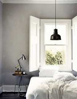 soft-white-comfortable-unmade-bed-hanging-black-lamp