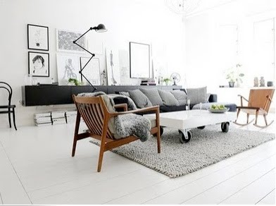 white-wood-floors-carpet-rug-black-accents