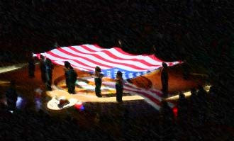 Sonics girls hold the American flag during the National Anthem