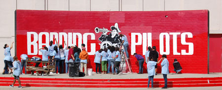 "Students work on the ""Banning Pilots"" mural on campus."