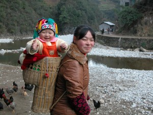 Woman with her child in China
