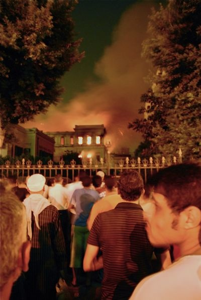 Crowds watch the Maglis al-Shura burn