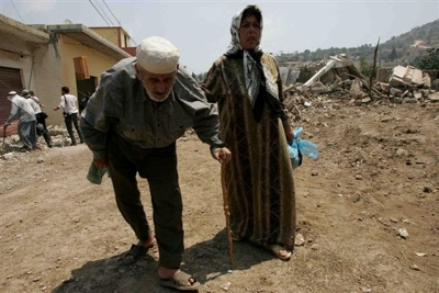 An Elderly Villager Is Helped By A Relative As They Make Their Way To Safer Ground After Spending More Than A Week In A Shelter At The Southern Village Of Aitaroun Ap
