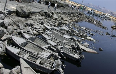 Fishing Boats Covered With Ashes Float Among Debris In The Uzai Port District Port Of South Beirut Destroyed In An Israeli Air Raid 04 August Afp