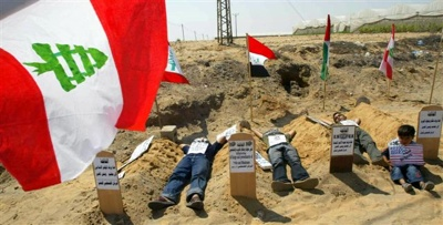 Palestinian Boys Sleep Next To Mock Graves Of Arab Rulers During A Protest In Rafah Refugee Camp Against The Lack Of Arab Support For Palestinians In Gaza And Lebanon July 23 Reuters