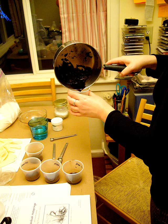 8.Pouring-dye-into-labeled-cups1e